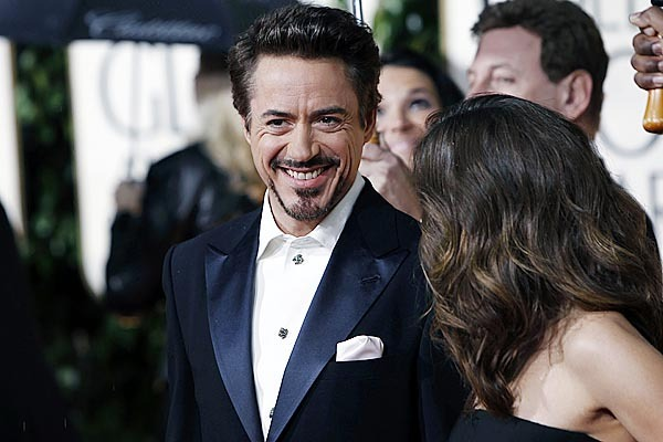 Robert Downey, Jr. and Susan Levin arrive at the 67th Annual Golden Globe Awards on Sunday, Jan. 17, 2010, in Beverly Hills, Calif. (AP Photo/Matt Sayles)