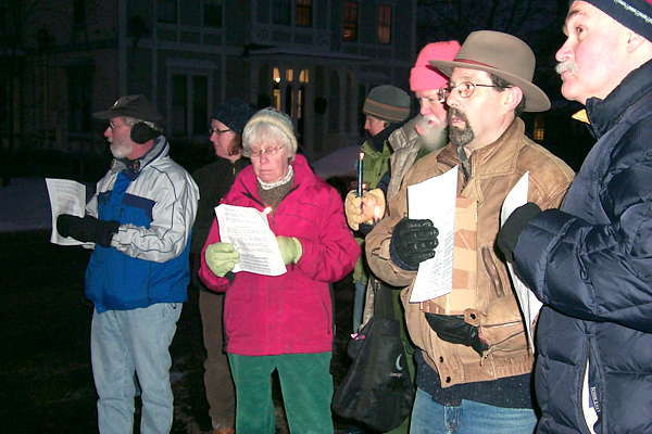 A group of about 30 people met in front of the Belfast Post Office at 4:30 p.m. Monday to celebrate Martin Luther King Jr.'s birthday. The group then walked to the First Church while singing &quotWe Shall Overcome.&quot BANGOR DAILY NEWS PHOTO BY HEATHER STEEVES
