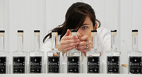 Jessica Jewell labels bottles of Twenty 2 vodka at the distillery she owns with her husband, Scott Galbiati, in Houlton on Friday, Jan. 8, 2010. The idea to maufacture vodka started as a college project then quickly turned into a family business. (Bangor Daily News/Kevin Bennett)