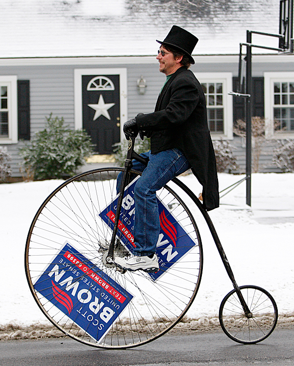 Matt Paturzo, a supporter of Massachusetts State Senator Scott Brown, R-Wrentham, rides a high-wheeler in Wrentham, Mass., Tuesday, Jan. 19, 2010. Brown is running against Democrat Martha Coakley in a special election to fill the U.S. Senate seat left empty by the death of Sen. Edward M. Kennedy, D-Mass. (AP Photo/Robert F. Bukaty)