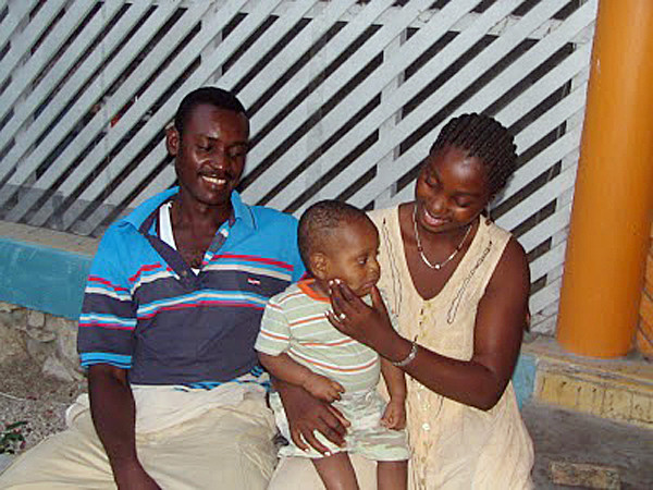 Isaac with his birth parents in Haiti. MEG HASKELL STORY