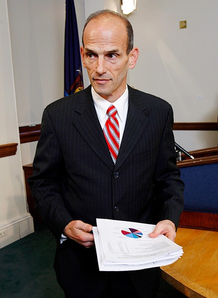 Gov.John Baldacci leaves a news conference after announcing his plans to close a $385 million budget gap, at the State House, Friday, Dec. 18, 2009, in Augusta, Maine. (AP Photo/Robert F. Bukaty)