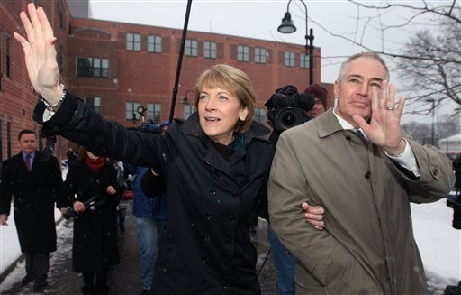 Democratic candidate, Massachusetts Attorney General Martha Coakley, left, and her husband Thomas F. O'Connor, Jr. wave to supporters outside the polling station where they cast their votes in the special election to replace former Sen. Edward Kennedy, D-Mass., Tuesday, Jan. 19, 2010 in Medford, Mass. (AP Photo/Bizuayehu Tesfaye)