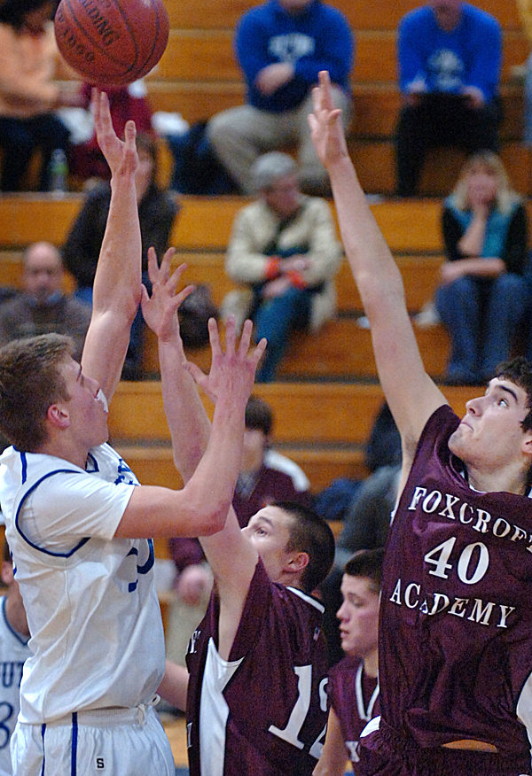 Stearns' Billy Eurich (left) goes up for a shot against Foxcroft Academy's Kyly Gould (center) and James Johnson in the first half of Tuesday's game, Jan. 19, 2010 at Stearns High School in Millinocket. Stearns won 62-50. BANGOR DAILY NEWS PHOTO BY BRIDGET BROWN