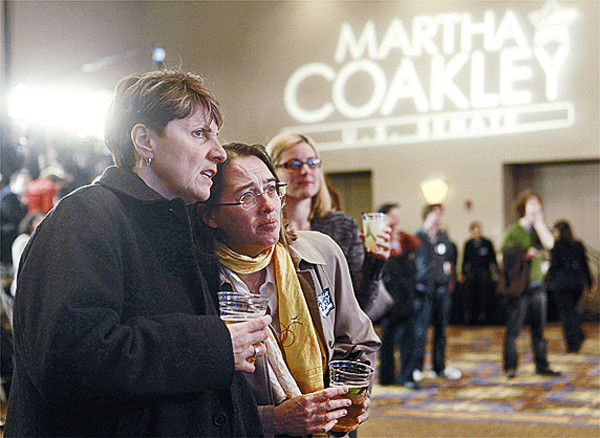 Supporters of Massachusetts Attorney General Martha Coakley, Maureen Kelly, left, and Donna Gagnon, second from left, both of Quincy, Mass., react to a vote tally displayed at Coakley's election-night headquarters in Boston, Tuesday, Jan. 19, 2010. Coakley, a Democrat, is on the ballot of a special election held to fill the U.S. Senate seat left vacant by the death of Sen. Edward Kennedy. Coakley is running against Mass. State Sen. Scott Brown, R-Wrentham, and a Libertarian running as an independent and not related to the late Sen. Kennedy.  (AP Photo/Steven Senne)