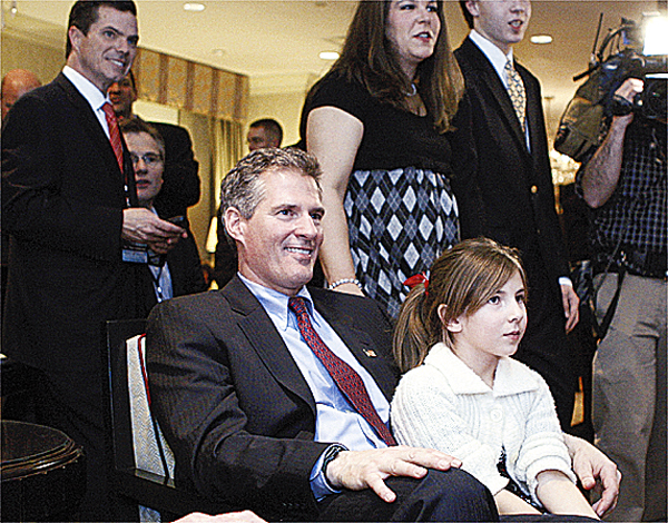 Massachusetts State Sen. Scott Brown, R-Wrentham, watches election night returns with family and supporters in his room in Boston, Tuesday, Jan. 19, 2010. Brown is on the ballot of a special election held to fill the U.S. Senate seat left vacant by the death of Sen. Edward Kennedy. He is running against Massachusetts Attorney General Martha Coakley, a Democrat, and Joseph L. Kennedy, a Libertarian running as an independent and not related to the late Sen. Kennedy. (AP Photo/Charles Krupa)