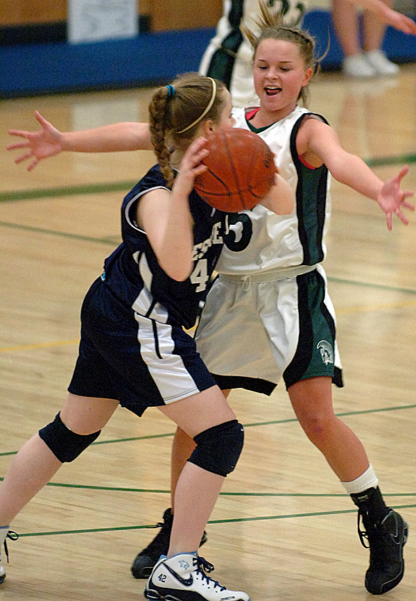 Presque Isle's Haley Johnston (left) looks to pass around Mount Desert Island's Sara Carroll in the first half of Wednesday's game, Jan. 20, 2010 in Bar Harbor. BANGOR DAILY NEWS PHOTO BY BRIDGET BROWN