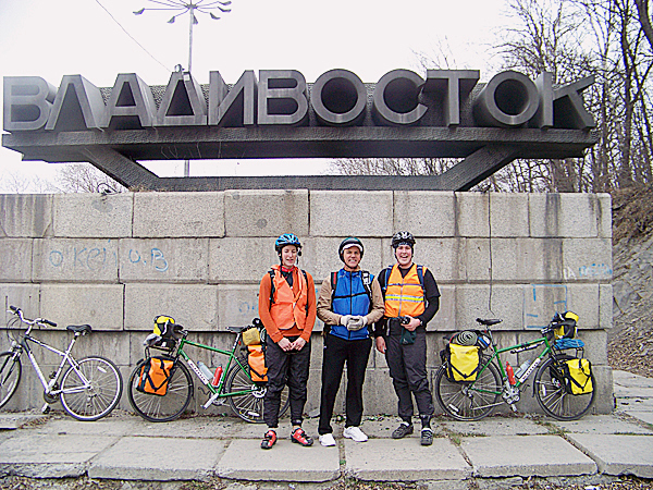 Anyone Can Do It: Ellery Althaus and Levi Bridges pose for a photo at the entrance to the Russian city of Vladivostok with American Consul General, Tom Armbruster, who escorted the two cyclists out of Vladivostok on bicycle April 15, 2009. The initial days of riding long distances in the cold are the hardest parts of a bicycle tour. In just several weeks, new muscles in a cyclists legs become strong enough to easily ride long distances continuously. But this was not the first day; in this photo, Bridges, Althaus and Armbruster all appear miserable. Nevertheless, for college friends Althaus and Bridges, the moment was the fulfillment of a long-held dream to cycle across Russia, the world's largest country.   LEVI BRIDGES PHOTO