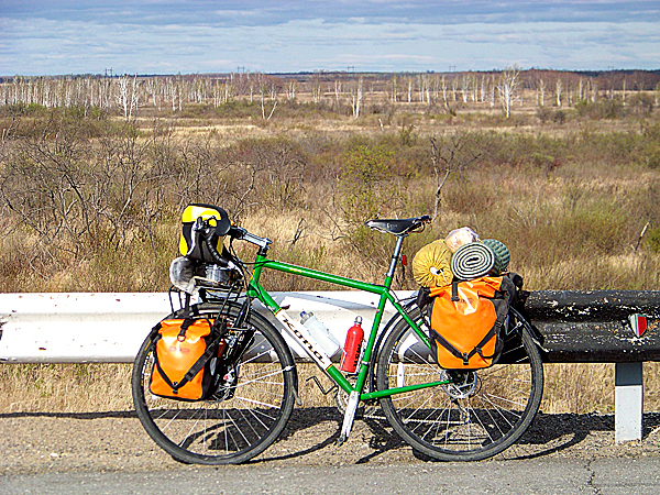 All You Get: Levi Bridges' bicycle (pictured above) equipped with the panniers, or small bags, he used to travel with for over eight months. The lack of space allowed the cyclists to carry only two pairs of underwear and one pair of pants.   LEVI BRIDGES PHOTO