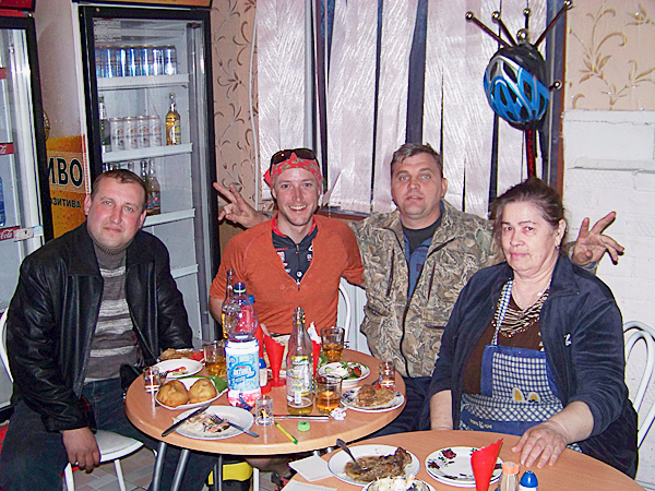 World's Best Kept Secret: Levi Bridges (second from the left) sits between several young Russian men and a kind babushka in a small Siberian cafe. These locals both fed the two New England cyclists for free and allowed them to sleep on the floor of an adjoining room. Many people imagine Russia as a land full of thieves who could potentially harm foreign travelers. Throughout their journey across Russia, the two New England cyclists were continually amazed by the hospitality they received from strangers. The trip left them with a better impression of mankind and the realization that nice people in this world far outnumber those who will try to abuse you.