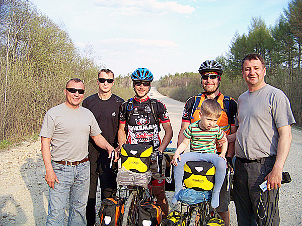 Posing with a group of Russians on a lonely dirt road cutting through a remote section of eastern Siberia. Many Russians frequently stopped to ask the two New England cyclists where they were going and what country they were from. Many also wanted to take a photo, but some, like the men pictured above, didn't have a camera but stopped anyway. Believing the two American cyclists were famous, they still wanted to have their pictures taken with them. &quotFriendly exchanges with curious people were the most memorable part of the trip,&quot says Maine cyclist Levi Bridges.   LEVI BRIDGES PHOTO