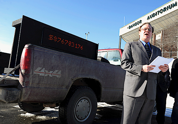 Greg Howard spokesman for &quotMaine Change that Works&quot holds a press conference on Friday, Jan. 22, 2010 in Bangor, next to a pickup truck containing a digital display with an escalating dollar figure that Howard says represents what Americans are paying in a hidden health care tax to pay for those Americans without health insurance.  BANGOR DAILY NEWS PHOTO BY KEVIN BENNETT