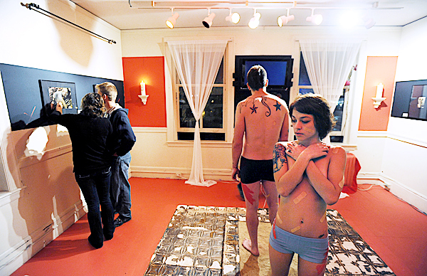Natasha Nadeau, right, stands partially clothed along with Eddie Sykes, second from right, as part of a living art piece titled &quotOver and Over&quot by Segio Ramos at his studio in downtown Bangor during the Downtown Bangor Arts Walk on Friday, November 20, 2009. (Bangor Daily News/Kevin Bennett)