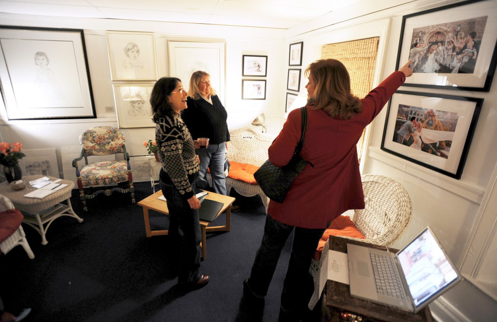 Artist Andrea Hand, left, shows off her work in her gallery in downtown Bangor to Kim Hillier, center, and Missy Houston, right, on Friday, November 20, 2009 during the Downtown Bangor Arts Walk.   BANGOR DAILY NEWS PHOTO BY KEVIN BENNETT