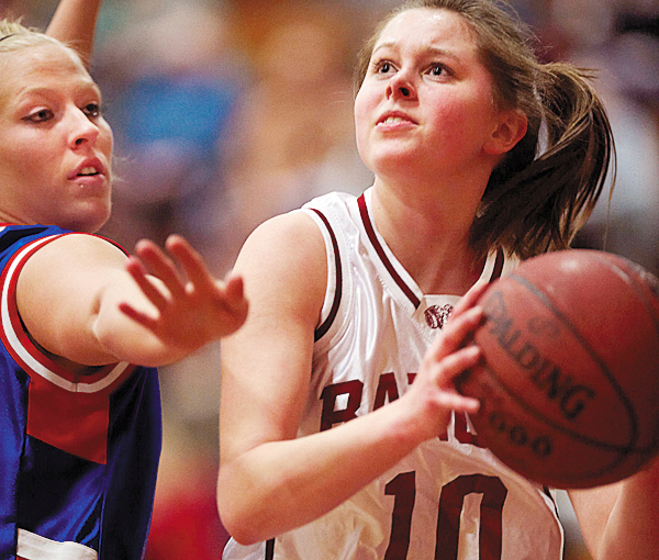 Bangor's Hillary Throckmorton, (10),  keeps her eyes on the hoop despite intense pressure from Mt Ararat's Miranda Riendeau, (33), in the first half of their game in Bangor, Friday, Jan. 22, 2010.  BANGOR DAILY NEWS PHOTO BY MICHAEL C. YORK
