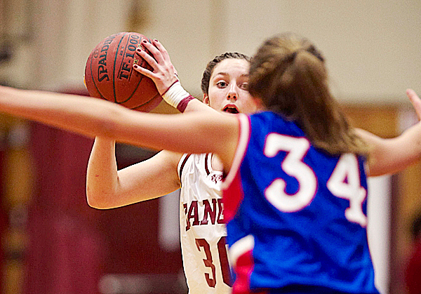 bANGOR'S Meaghan Doucette, (30), looks for an open pass over the arms of Mt Ararat's Hannah  Fenwick, (34), in the first half of their game in Bangor, Friday, Jan. 22, 2010.   BANGOR DAILY NEWS PHOTO BY MICHAEL C. YORK
