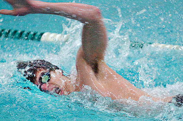 Ian Carbone of Mount Desert Island races in the boys 100-yard freestyle Friday, Jan. 22, 2010 at Husson University in Bangor. Carbone placed first ahead of Joey Quinn of Bangor with a time of 49.77.  BANGOR DAILY NEWS PHOTO BY BRIDGET BROWN