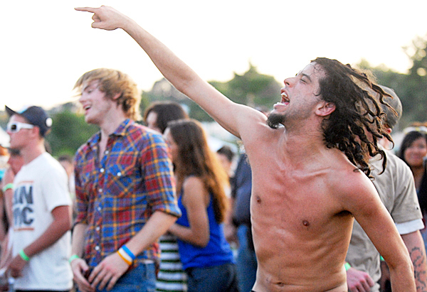 James Morang, 22, of Bangor rocks out with others as they listen to  Bangor legends The Killing Moon who reunited for an evening gig at Saturday's KahBang Music and Arts Festival on Bangor's waterfront. The band members were classmates of Morang's at Hampden Academy. BANGOR DAILY NEWS PHOTO BY JOHN CLARKE RUSS