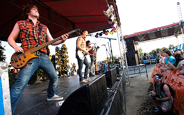 From left: Trevor Geaghan, Ryan Hannan, Chris Michaud and Jeremy Yehle (obscured) members of Bangor legend band, The Killing Moon, reunited for an evening gig at Saturday's KahBang Music and Arts Festival on Bangor's waterfront. They all live in Hampden.  BANGOR DAILY NEWS PHOTO BY JOHN CLARKE RUSS