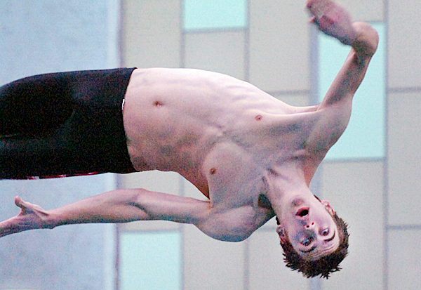Ross Cormier of Bangor dives during a meet against Mount Desert Island on Friday, Jan. 22, 2010 at Husson University in Bangor.   BANGOR DAILY NEWS PHOTO BY BRIDGET BROWN