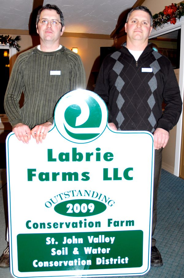 Duane Labrie (left) and Keith Labrie of Labrie Family Farms were named the 2009 outstanding conservation farm Friday night at the St. John Valley Soil and Water Conservation District annual banquet. Their father Daniel Labrie was also honored for his 20 years of working with the district.   BANGOR DAILY NEWS PHOTO BY JULIA BAYLY