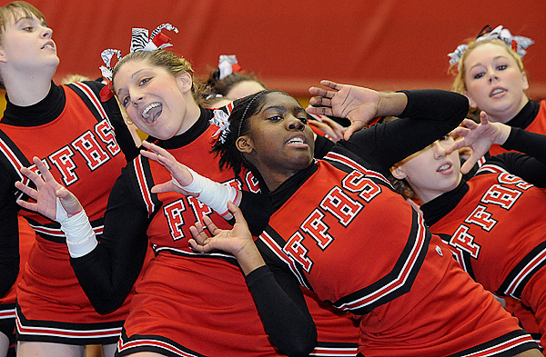 The Fort Fairfield Tigers cheering squad performs during the Class D Eastern Maine Cheering Championships at the Bangor Auditorium Saturday. BANGOR DAILY NEWS PHOTO BY GABOR DEGRE
