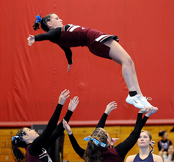 The Buckfield High School cheering squad performs during the Class D Eastern Maine Cheering Championships at the Bangor Auditorium Saturday.  The squad finished in third place. BANGOR DAILY NEWS PHOTO BY GABOR DEGRE