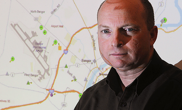 John Cobb, an infrasturcture analyst with Bangor Hydro, with a projected map showing the location of some company vehicles in Bangor recently.  Cobb was instrumental in the installing of new cellular technology in the company's vehicle fleet.  The devices send information to the dispatch center on the exact location of each vehicle allowing more effective response to problems.  The technology also transmits emergency signals, vehicle location travel history and diagnostics data. BANGOR DAILY NEWS PHOTO BY GABOR DEGRE