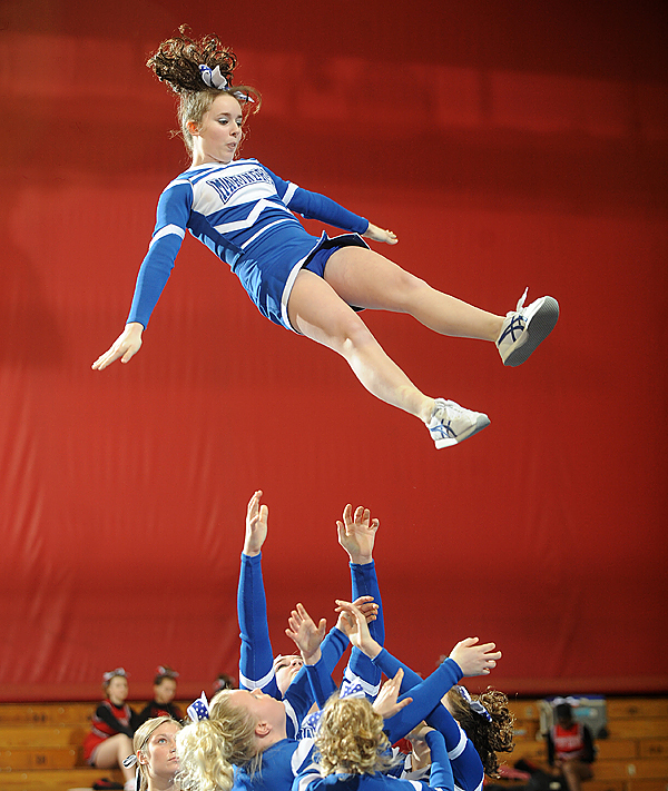 The Deer Isle-Stonington High School cheering squad performs during the Class D Eastern Maine Cheering Championships at the Bangor Auditorium Saturday.  The squad finished in second place. BANGOR DAILY NEWS PHOTO BY GABOR DEGRE
