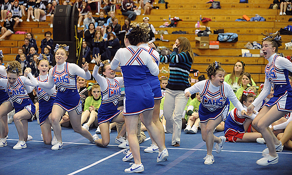 The Central Aroostook High School cheering squad celebrates their first place finish in the Class D Eastern Maine Cheering Championships at the bangor Auditorium Saturday. BANGOR DAILY NEWS PHOTO BY GABOR DEGRE