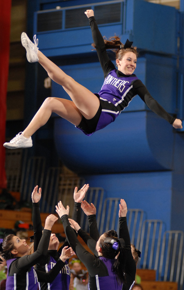 Waterville's Sarah Trottier hits a can kick at the Regional Cheerleading Competition on Saturday at the Bangor Auditorium where the Panthers placed 5th and will advance onto the State Championship. BANGOR DAILY NEWS PHOTO BY LINDA COAN O'KRESIK