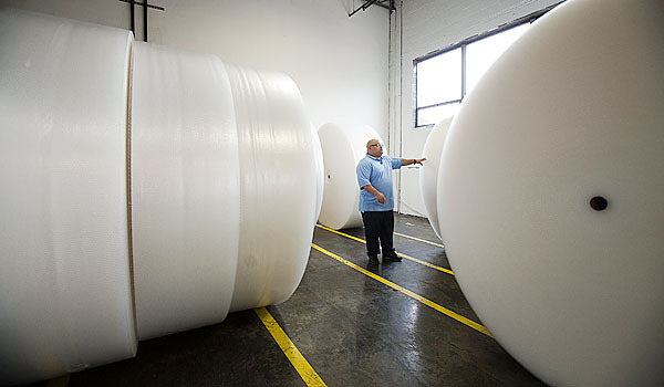In this Jan. 19, 2010 photo, Sealed Air Production Manager Roberto Ramos surveys giant rolls of Bubble Wrap at the company's plant in Saddle Brook, N.J. Sealed Air is celebrating the 50th anniversary of Bubble Wrap this month. (AP Photo/Christopher Barth)