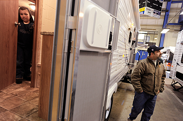 Ethan Desjardin (left), 7, of Eastbrook checks out the bathroom in the Jayco Flight RV as David Boudreau of Holden looks for a possible replacement for his own RV at the 24th annual Camping and RV Show at the Bangor Civic Center on Saturday. BANGOR DAILY NEWS FILE PHOTO BY JOHN CLARKE RUSS