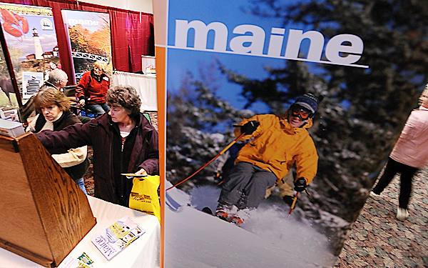 Lorelle St. Germain (left) of Mount Desert Island and Clarice Hannan of Carmel pick up camping borchures at the Maine Campground Owners Association booth at the Camping and RV show.  BANGOR DAILY NEWS FILE PHOTO BY JOHN CLARKE RUSS