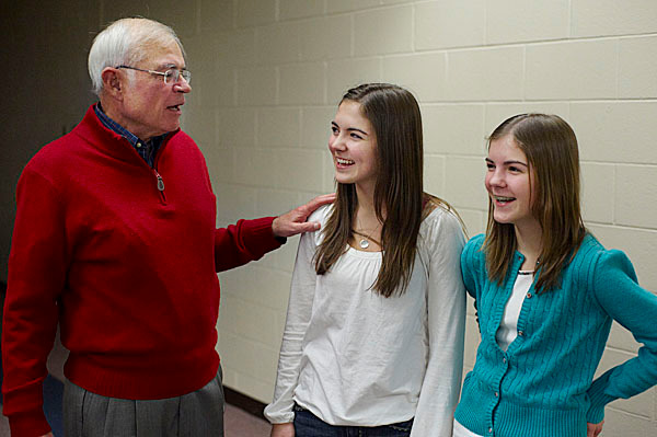 Voice of the Boston Red Sox, Joe Castiglione, talks with his neices ,L/R, Emily, and Olivia Gower , of Hampden, Maine, before the start of the Hot Stove session at the Bangor Civic Center, Monday, Jan. 25, 2010. BANGOR DAILY NEWS PHOTO BY MICHAEL C. YORK