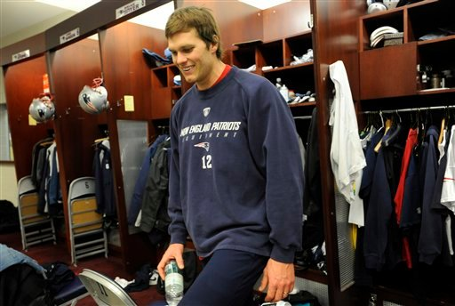 New England Patriots quarterback Tom Brady walks in front of his locker following practice at the NFL football team's facility in Foxborough, Mass., Wednesday, Jan. 6, 2010.  Brady's strong return from a left knee injury that cost him an entire season has earned the Patriots quarterback The Associated Press 2009 NFL Comeback Player of the Year award.  (AP Photo/Gretchen Ertl)