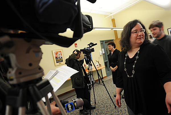 American Folk Festival Executive Director Heather McCarthy, foreground, and Board of Directors Chairwoman Maria Baeza, background, prepare for one-on-one interviews with the media on Tuesday, Jan. 26, 2010, after the 2010 budget for the musical festival was announced at a downtown press conference. BANGOR DAILY NEWS PHOTO BY KEVIN BENNETT