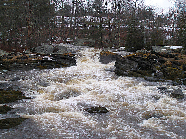 Swollen with Monday night's rain, the waters of Patten Stream roil into Patten Bay in Surry. BANGOR DAILY NEWS PHOTO BY RICH HEWITT