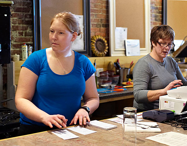 Colby and Kim, L/R, daughter and mother, deal with the business of busy lunchtime orders at Bennet's Market/Unbridled Bistro, Wed., Jan. 27, 2010. BANGOR DAILY NEWS PHOTO BY MICHAEL C. YORK