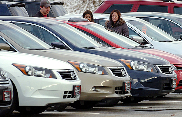 Potential customers browse the lot at Down East Toyota on Wednesday, Jan. 27, 2010 in Brewer, the day after Toyota announced a suspension of sales on eight models due to a sticking accelerator pedal. &quotWe've got more than half our cars that are still for sale,&quot said Down East General Manager Kevin Kelly on Wednesday, who also estimated about 35 percent of the dealership's stock of vehicles were affected by the sales suspension. BANGOR DAILY NEWS PHOTO BY BRIDGET BROWN