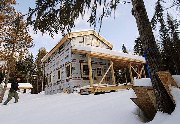 Sgt. Chris Cloutier of the Dept. of Inland Fisheries and Wildlife's Greenville regional office, trudges to the department's soon-to-be finished camp lodging on Baker Lake in located in T7 R17 WELS. Cloutier gave the BDN a tour of the lodging on December 28, 2009. BANGOR DAILY NEWS PHOTO BY JOHN CLARKE RUSS