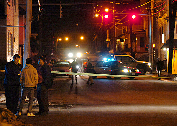 Bangor Police Detective Eric Tall (left) questions David Carr of Bangor (right) and his son David, 17, following a shooting on Cumberland Street in Bangor on Wednesday evening, Jan. 27, 2010, shortly after 6 p.m. Carr called the police after a 19-year-old male was shot and then said he stayed with the victim, wrapping him in blankets and praying with him. Police have not released the victim's name and are still searching for a suspect. They are also urging anyone who saw the shooting or knows anything about it to contact the Bangor Police Department. BANGOR DAILY NEWS PHOTO BY BRIDGET BROWN
