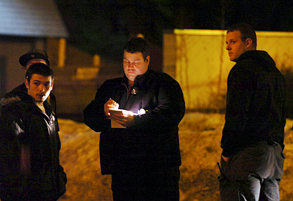 Bangor Police Detective Eric Tall (center) talks to two young men (left) alongside a fellow investigator (right) following a shooting on Cumberland Street in Bangor on Wednesday evening, Jan. 27, 2010, shortly after 6 p.m. Police have not released the victim's name, who was taken to Eastern Maine Medical Center, and are still searching for a suspect. They are also urging anyone who saw the shooting or knows anything about it to contact the Bangor Police Department. BANGOR DAILY NEWS PHOTO BY BRIDGET BROWN