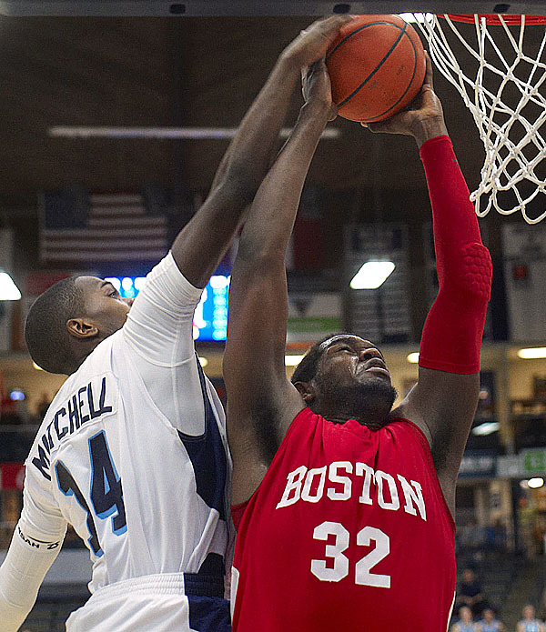 Jeff Pelage, (32), gets his jam attempt blocked by Maine's Terrance Mitchell, (14), in the second half of their game inOrono, Maine, Wed., Jan. 27, 2010.Bangor Daily NEws/Michael C. York