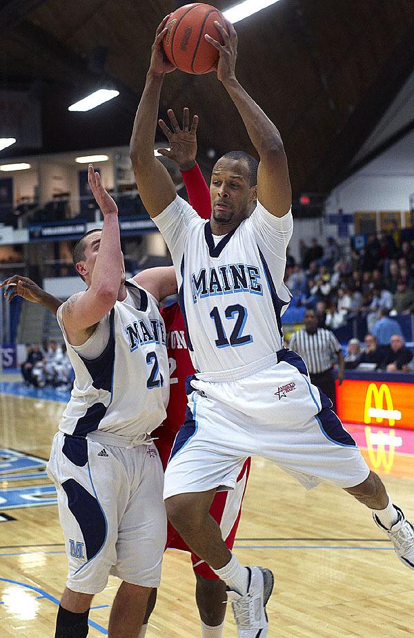 Maine's Junior Bernal, (12), grabs a defensive rebound in the second half of their game versus BU in Orono, Maine, Jan. 27, 2010.Bangor Daily NEws/Michael C. York