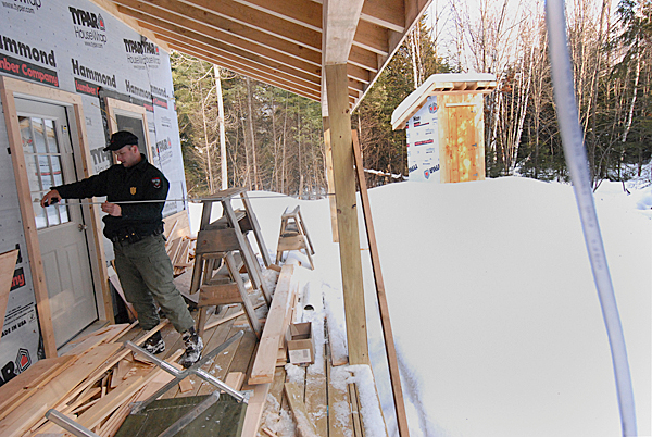 D.I.F.W. Sgt. Chris Cloutier takes dimension measurements of the soon-to-be completed D.I.F.W. lodging on Baker Lake in T7 R17 WELS while giving the BDN a tour on December 28, 2009. BANGOR DAILY NEWS PHOTO BY JOHN CLARKE RUSS