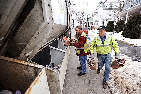 City of Bangor Public Works employees Rich LeGasse, left, and Arthur Koch, right, sort recyclables curbside as they criss-cross Bangor city streets on Thursday, Jan. 28, 2010. The City of Bangor is considering a single stream recycle program aimed at getting more households to participate in recycling. Single stream recycle programs require no sorting by residents. BANGOR DAILY NEWS PHOTO BY KEVIN BENNETT