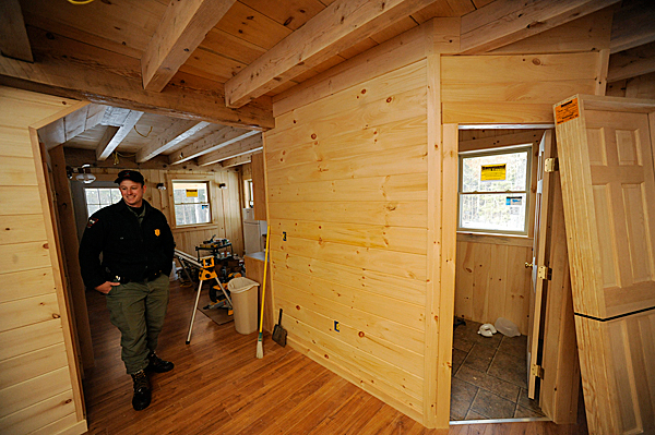D.I.F.W. Sgt. Chris Cloutier shows off  the first floor of the soon-to-be completed D.I.F.W. lodging on Baker Lake in T7 R17 WELS on December 28, 2009. BANGOR DAILY NEWS PHOTO BY JOHN CLARKE RUSS