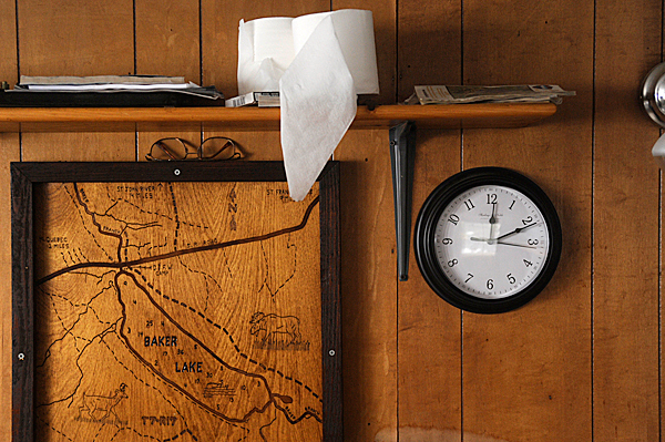 Above the kitchen table of the soon-to-be-razed camp house at the confluence of the Baker Branch and Baker Lake are wardens' personal effects including a wood-burned map of the area, glasses and toilet paper. The old camp house is next to the the Dept. of Inland Fisheries and Wildlife's soon-to-be finished new camp lodging on Baker Lake in T7 R17 WELS. D.I.F.W. Sgt. Chris Cloutier gave the BDN a tour of the old and new lodging on December 28, 2009. BANGOR DAILY NEWS PHOTO BY JOHN CLARKE RUSS