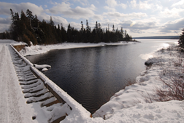Viewed from the bridge in T7 R17 WELS is the parcel on the Baker Branch of the St. John River and Baker Lake where the D.I.F.W. is building new camp lodging (obscured in the tree line).  Sgt. Chris Cloutier of the Dept. of Inland Fisheries and Wildlife's Greenville regional office,  gave the BDN a tour of the their soon-to-be completed lodging on December 28, 2009. BANGOR DAILY NEWS PHOTO BY JOHN CLARKE RUSS